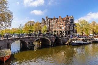 Amsterdam city skyline at canal waterfront, Amsterdam, Netherlands
