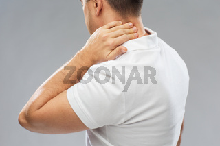close up of man suffering from neck pain