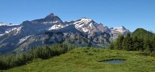 Mount Oldenhorn and pond. Summer scene  near Gstaad, Switzerland.