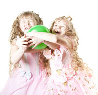 Twin sisters playing