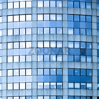 Abstract square crop of blue business office skyscraper