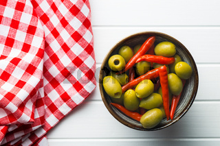 Pickled chili peppers and green olives.