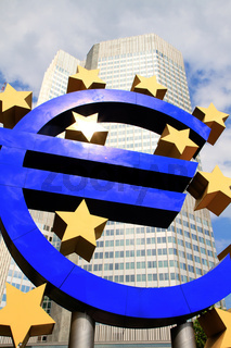 EURO sign in front of a skyscraper