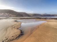 Deserted sandy tidal beach at Agiou, Morocco