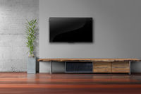 led tv on gray wall with wooden table in livg room