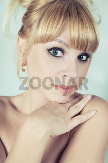 Studio portrait of a beautiful blonde girl close-up