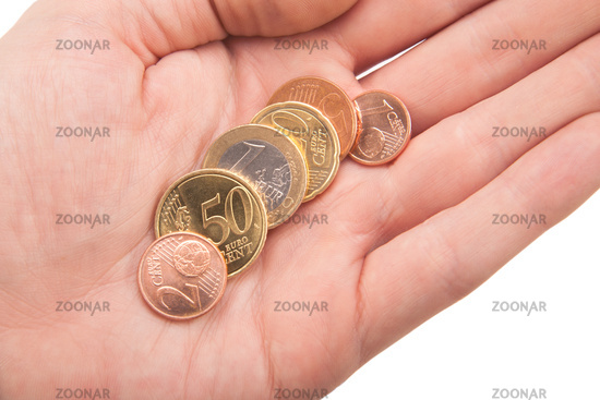 handful of euro coins in hand