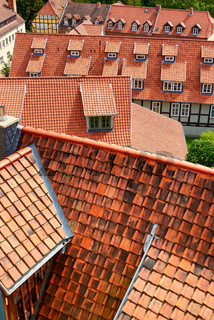 rooftop with many red shingles in town