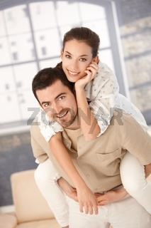 Happy young couple having fun at home