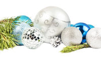 New year and Christmas composition with fir tree branch, beautiful silver ball and blue balls