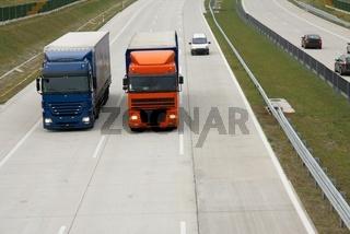Trucks running on the highway