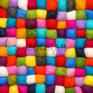 color wool background - balls of syntetic wool yarn - geometric rainbow pattern