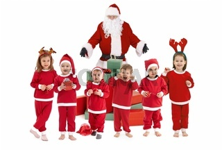 Santa Claus with happy little children in costume
