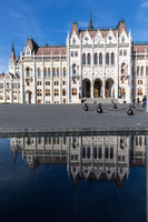 Beautiful reflection view of Budapest Parliament. Parliament Building. Hungary Budapest. View from square to Parlament.