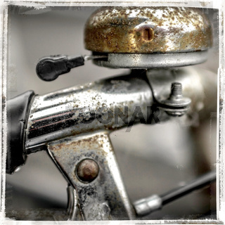 Old bicycle bell with rust