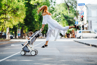 mom with a stroller crosses the road