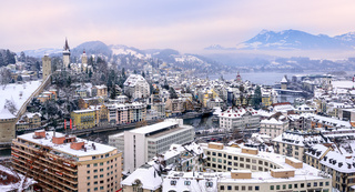 Lucerne, Switzerland, view of the old town, city wall towers, and Alps mountains