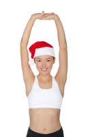 asian woman in Santa's hat engaged in fitness