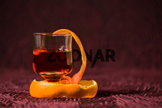 Closeup of alcoholic punch drink with orange peel