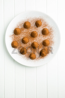 Sweet chocolate truffles and cocoa powder.