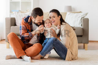 happy family with baby having fun at home