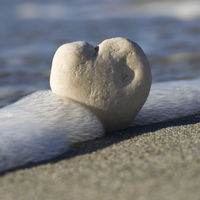 white stone heart in the water