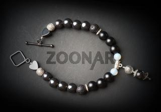 jewel bracelet with semipreciouse stones at black background