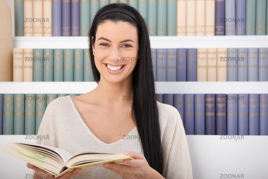 Laughing woman with book