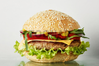 Fresh burger with beef, cheese and tomatoes.