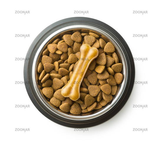 Dog chew bone and dry kibble dog food.