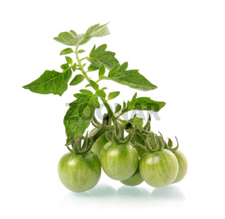 Heap of ripe tomatoes vegetable with green leafs