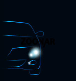 Silhouette of car with headlights in darkness