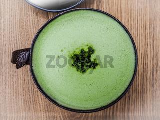 Green tea latte coffee in green tea shop at Osulloc tea museum, Jeju island, South Korea.