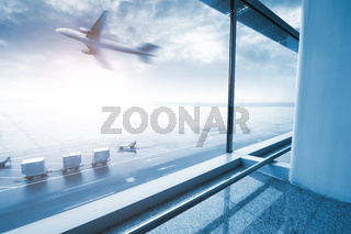 modern airport scene of passenger motion blur with window outside.