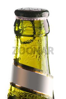 yellow bottle of beer with water drops