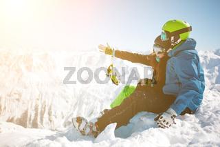 Girl , guy among winter mountain