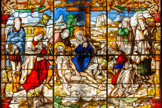 Beautiful stained glass window depicting the resurrection of Jesus, celebrated on Easter Sunday