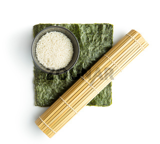 Green nori sheet , rice and bamboo mat.