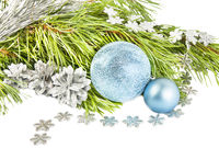 New year and Christmas composition with fir tree, cones and silver ball on white