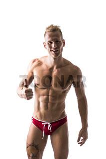 Muscular man shirtless doing thumb up sign for OK