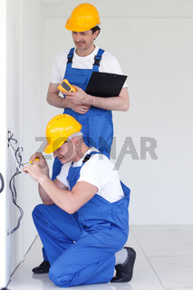 Builders working with electricity