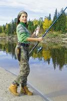 Beautiful girl on a fishing trip in the taiga