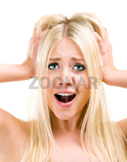 Amazed woman looking at camera