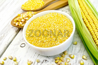 Corn grits in white bowl on light board
