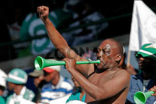 Soccer fan blowing a Vuvuzela