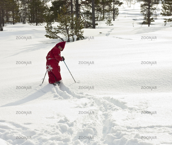 Child skiing off the path