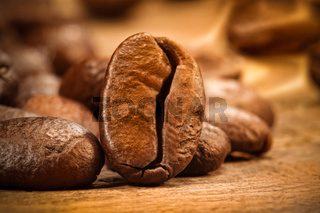 Closeup shot of a coffee bean on wood