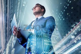 Businessman against buildings in business concept