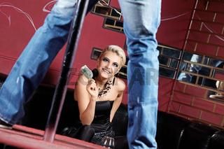The man dances a striptease for the girl