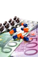 Medikamente auf Geldscheinen